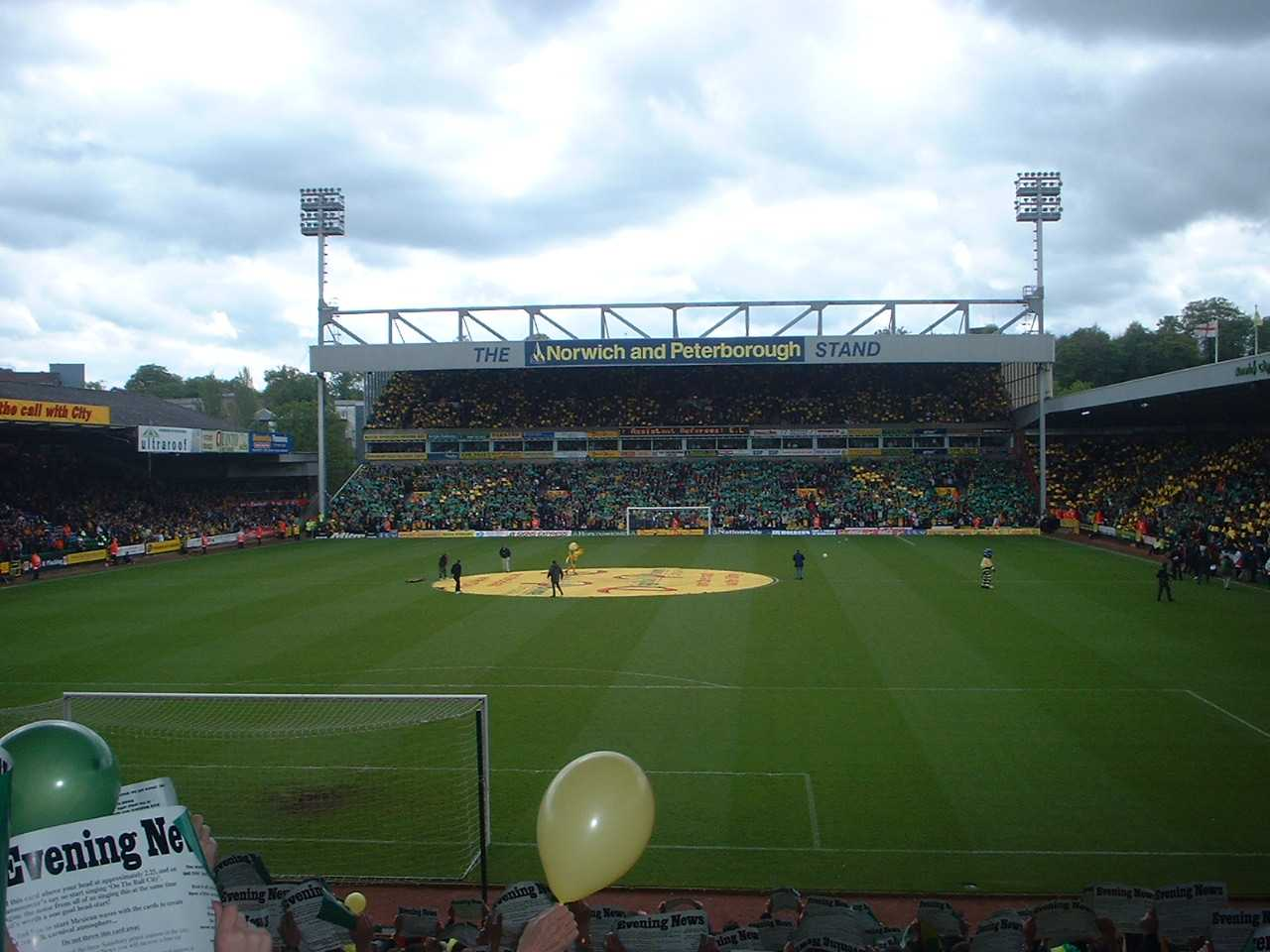 Carrow_Road_-_fans_holding_yellow_or_green_fliers